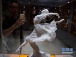 فنون صناعة التماثيل الخزفية لمحافظة دهوا .jpg