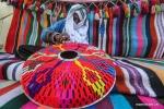 خياطة زخارف بدوية تقليدية من الصوف في غزة .jpg
